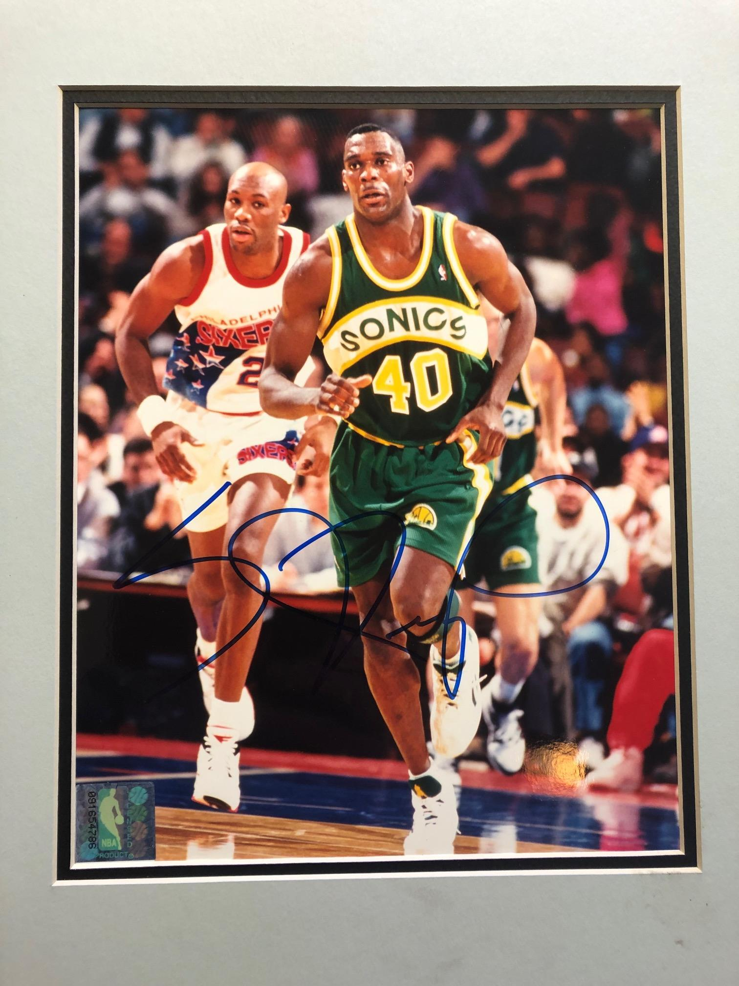 Matted and framed autographed photo of the legendary Shawn Kemp!
